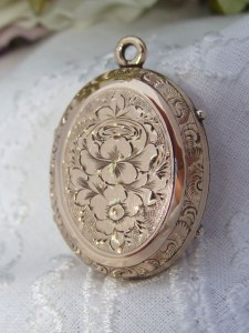 Antique Victorian 12K 12ct  PinkA locket from the romantic and nostalgic Victorian era in this condition is very Rare. It is an Exceptional example of MUSEUM QUALITY from the era showcasing two different hand-chased floral designs and is completely intact